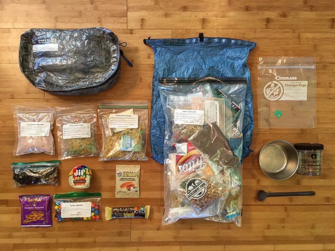 Twenty-two ultralight backpacking meal preparation and menu planning tips for your next thru-hike or backpacking adventure. #backcountryfoodie #backpackingmeals #ultralightbackpacking